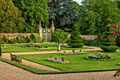 ANONS ASHBY, NORTHAMPTONSHIRE, THE NATIONAL TRUST - LAWN, BEDDING, GRAVEL PATHS, CLIPPED TOPIARY YEWS, WALL, GATE, JULY
