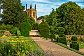 CANONS ASHBY, NORTHAMPTONSHIRE, THE NATIONAL TRUST - LAWN, BEDDING, CHURCH, BORDER, TOPIARY, GRAVEL PATH, JULY, FORMAL, GARDEN