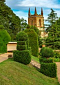 CANONS ASHBY, NORTHAMPTONSHIRE, THE NATIONAL TRUST - LAWN, CHURCH, CLIPPED TOPIARY YEWS, JULY, FORMAL, GARDEN