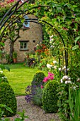 ADAMS POOL, GLOUCESTERSHIRE: BORDER BY LAWN, BOX TOPIARY, PHLOX, ARCHWAY, LAWN, BORDER, COTTAGE, GARDEN, COTSWOLDS