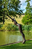 GLYNDEBOURNE, EAST SUSSEX: LAKE, LAWN, SCULPTURE OF DIVING LADY BY CAROL PEACE