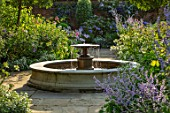 MORTON HALL, WORCESTERSHIRE: SOUTH GARDEN, JULY, FOUNTAIN, PEROVSKIA BLUE SPIRE, AGAPANTHUS POLAR ICE, AGAPANTHUS BLUE TRIUMPHATOR, ANAPHALIS TRIPLINERVIS SUMMER SNOW