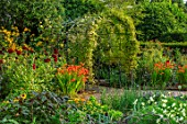 MORTON HALL GARDENS, WORCESTERSHIRE: KITCHEN GARDEN, CROCOSMIA OKOVANGO, FOENICULUM VULGARE GIANT BRONZE, DAHLIA KARMA CHOC, JULY, BORDERS, KITCHEN, ARCH