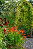 MORTON HALL GARDENS, WORCESTERSHIRE: KITCHEN GARDEN, CROCOSMIA OKOVANGO, DAHLIA KARMA CHOC, JULY, BORDERS, KITCHEN, ARCH