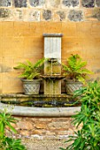 PRIVATE GARDEN, GLOUCESTERSHIRE - DESIGNER ANGEL COLLINS: WALL FOUNTAIN WITH FERNS, WATER, SPOUT