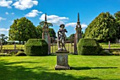 CANONS ASHBY, NORTHAMPTONSHIRE, THE NATIONAL TRUST: GREEN COURT, GATES, YEW TOPIARY, LEAD STATUE OF SHEPHERD BOY FROM A MODEL BY JAN VON NOST