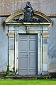CANONS ASHBY, NORTHAMPTONSHIRE, THE NATIONAL TRUST: GREEN COURT,  THE WEST FRONT, DOOR, COAT OF ARMS CAST IN LEAD