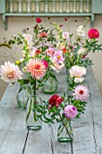 GREEN AND GORGEOUS FLOWERS, OXFORDSHIRE: TABLE ARRANGEMENT OF GLASS VASES FOR WEDDING ALONG GREY, BLUE TABLE - DAHLIAS, FALL, AUTUMN, BLOOMING, BULBS