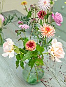 GREEN AND GORGEOUS FLOWERS, OXFORDSHIRE: TABLE ARRANGEMENT OF GLASS VASE FOR WEDDING ALONG GREY, BLUE TABLE - DAHLIAS, ZINNIAS, ROSES, FALL, AUTUMN, BLOOMING, BULBS