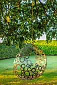 MITTON MANOR, STAFFORDSHIRE: BEECH TREE, BUBBLE SWING SEAT BY MYBURGH DESIGNS, SEPTEMBER, LAWN, TREES, SWINGS, SEATING