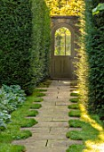 ROCKCLIFFE GARDEN, GLOUCESTERSHIRE: PATH EDGED WITH GRASS, YEW HEDGES, HEDGING, DOOR INTO SWIMMING POOL GARDEN, SEPTEMBER, ENGLISH, COUNTRY, GARDENS