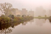FORDE ABBEY, SOMERSET: FORDE ABBEY, SOMERSET: LONG POND IN OCTOBER, MIST, FOG, DAWN, SUNRISE, WATER, FORMAL, POND, POOL, CLIPPED, YEW, TOPIARY, AUTUMN, ENGLISH, COUNTRY, GARDEN
