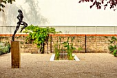 DESIGNER ANTHONY PAUL: SMALL, TOWN, FORMAL, GRAVEL, WATER FEATURE, POOL, POND, CANAL, LONDON, WALL, TRELLIS, PATIO, SCULPTURE, WALLS