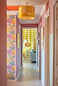 RACHEL HENDERSON HOUSE, EDINBURGH, SCOTLAND: COLOURFUL VIEW TO LIVING ROOM. BRIGHT, PINK, YELLOW
