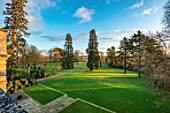 MORTON HALL GARDENS, WORCESTERSHIRE: LAWN, MEADOW, PARKLAND FROM ROOF OF HALL. SEQUOIADENDRON GIGANTEUM, WELLINGTONIA, GIANT SEQUOIA, GIANT REDWOOD, CONIFERS
