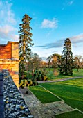 MORTON HALL GARDENS, WORCESTERSHIRE: TOPIARY BALLS AND SCOTS PINE, PINUS SYLVESTRIS, PARKLAND, LAWN, FROM ROOF OF HALL, WINTER, JANUARY