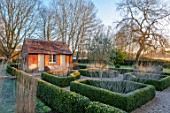 ST TIMOTHEE, BERKSHIRE - FOSTY, CLIPPED TOPIARY BOX PARTERRE, PEROVSKIA, OLIVE TREE, OUTBUILDING, WINTER, JANUARY, FROST, ENGLISH, COUNTRY, GARDEN