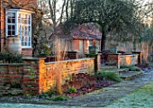ST TIMOTHEE, BERKSHIRE - WALL, HEUCHERA, SEDUMS, HOUSE, TERRACOTTA CONTAINER, WINTER, JANUARY, FROST, FROSTY, ENGLISH, COUNTRY, GARDEN