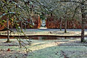 BRYANS GROUND, HEREFORDSHIRE - WINTER GARDEN, FROST, FROSTY, SERPENTINE CANAL, JANUARY, FRUIT TREES, HEDGE, HEDGING, BEECH, VISTA, VIEW, ALONG