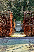 BRYANS GROUND, HEREFORDSHIRE - WINTER GARDEN, FROST, FROSTY, JANUARY, GAP THROUGH HEDGE, HEDGING, BEECH, VISTA, VIEW, ALONG, WOODEN, SEAT, BENCH, FOCAL POINT