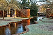 BRYANS GROUND, HEREFORDSHIRE - WINTER GARDEN, FROST, FROSTY, SERPENTINE CANAL, JANUARY, WATER, BUILDING, REFLECTED, REFLECTIONS, HEDGE, HEDGING, BEECH, VISTA, VIEW, ALONG