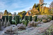 BRYANS GROUND, HEREFORDSHIRE - CLIPPED TOPIARY IN THE SUNK GARDEN, HEDGES, HEDGING, FROST, FROSTY, WINTER, LANTERN FOLLY, IRISH YEWS, FORMAL, PATH