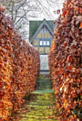 BRYANS GROUND, HEREFORDSHIRE: PATH TO THE DOVECOTE THROUGH BEECH HEDGES, HEDGING, HEDGE, BUILDING, ARTS AND CRAFTS, COUNTRY, GARDEN, WINTER, FROST, FROSTY, JANUARY