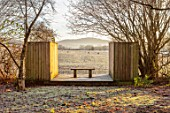 BRYANS GROUND, HEREFORDSHIRE: THE LIGHTBOX, CRICKET WOOD, WINTER, WOODLAND, WOODEN BENCH, SEAT, COUNTRY GARDEN, FROST, FROSTY, BORROWED, LANDSCAPE, VIEW, FOCAL POINT
