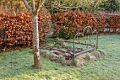 BRYANS GROUND, HEREFORDSHIRE: OLD RUSTY BED SCULPTURE, FROST, FROSTY, WINTER, JANUARY, GARDEN, ORNAMENT, FORMAL, HEDGING, HEDGES, BEECH
