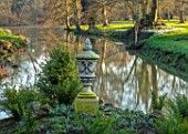 EYTHROPE, WADDESDON, BUCKINGHAMSHIRE: LAKE, SNOWDROP ISLAND, URN, CONTAINER, PARKLAND, TREES, WATER, WINTER, JANUARY, GALANTHUS, REFLECTIONS, REFLECTED