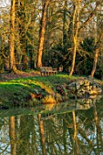 EYTHROPE, WADDESDON, BUCKINGHAMSHIRE: PARKLAND, TREES, WINTER, JANUARY, LAKE, WATER, REFLECTIONS, REFLECTED, BENCH, SEAT, SEATING