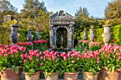 ARUNDEL CASTLE GARDENS, WEST SUSSEX: COLLECTOR EARLS GARDEN, TERRACOTTA CONTAINERS WITH TULIP PINK IMPRESSION, WATERFALL, FOUNTAIN, FOLLY, FOLLIES