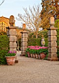 ARUNDEL CASTLE GARDENS, WEST SUSSEX: COLLECTOR EARLS GARDEN, TERRACOTTA CONTAINERS WITH TULIP PINK IMPRESSION, WOODEN FOUNTAINS, FOUNTAIN, SPRING, APRIL