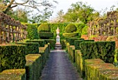 THE LASKETT GARDENS, HEREFORDSHIRE. DESIGNER ROY STRONG - ELIZABETH TUDOR WALK, FORMAL GARDEN, SPRING, VISTA, PATH, IRISH YEW TOPIARY HEDGES, PLEACHED LIMES, HEDGING