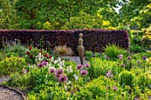 THE PICTON GARDEN AND OLD COURT NURSERIES, WORCESTERSHIRE: MAY, SPRING, BORDER WITH ALLIUM UNIVERSE, PAMONA SCULPTURE BY VICTORIA WESTAWAY