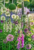 ORDNANCE HOUSE, WILTSHIRE: COMBINATION, ASSOCIATION, ALLIUM PURPLE SENSATION, FOXGLOVES, DIGITALIS CAMELOT CREAM, PURPLE, ROSE, ALLIUM MOUNT EVEREST, WHITE, PINK, PURPLE, MAY