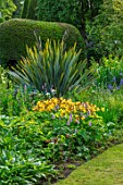 YORK GATE, YORKSHIRE: THE OLD ORCHARD, LAWN, IRIS PSEUDACORUS VAR. BASTARDII, POLYGONUM BISTORTA SUPERBUM, HEMEROCALLIS CORKY, POOL, POND, WATER, TREE SEAT, PHORMIUM