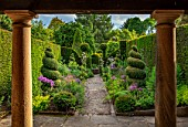 YORK GATE, YORKSHIRE: PORTICO, PATH, HERB GARDEN, CLIPPED, TOPIARY, BOX , YEW, SUMMERHOUSE, HEDGES, HEDGING, SUMMER, JUNE, ALLIUMS