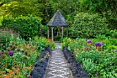 YORK GATE, YORKSHIRE: PATH, WOODEN, GAZEBO, FOLLY, BORDERS, JUNE, SUMMER, CANAL GARDEN, OPHIOPOGON NIGRESCENS, ALLIUMS, POPPIES