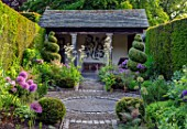 YORK GATE, YORKSHIRE: PORTICO, PATH, HERB GARDEN, CLIPPED, TOPIARY, BOX , YEW, SUMMERHOUSE, HEDGES, HEDGING, SUMMER, JUNE, ALLIUMS, SUMMER, HOUSE