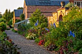 MORTON HALL GARDENS, WORCESTERSHIRE: KITCHEN GARDEN, POTAGER, GRAVEL, PATH, WALLS, WALLED, BORDERS, DELPHINIUM CUPID, SALVIA CARADONNA, ACHILLEA NOBILIS NEILREICHII, JUNE, SUMMER