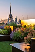 ROOF GARDEN, LONDON, DESIGNERS ANA SANCHEZ - MARTIN, LUCY WILLCOX - ROOF GARDEN, ASTROTURF, POWDER COATED ALUMINIUM SEATS, WALL, EUPHORBIA X MARTINII, HEBE, LAVENDER GRAPPENHALL