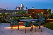 ROOF GARDEN, LONDON, DESIGNERS ANA SANCHEZ , MARTIN, LUCY WILLCOX - ROOF GARDEN, ASTROTURF, POWDER COATED ALUMINIUM WALL, EUPHORBIA X MARTINII, TABLE, CHAIRS, LIGHTING, PATIO