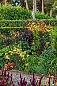 MORTON HALL GARDENS, WORCESTERSHIRE: WEST GARDEN, HOT BORDERS, ORANGE FLOWERS OF LILIUM HENRYI, SALVIA AMISTAD, ACHILLEA, HEUCHERA, SUMMER