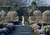 VIEW ALONG PATH TO SUNDIAL IN FROST COVERED SCENTED GARDEN HATFIELD HOUSE  HERTFORDSHIRE