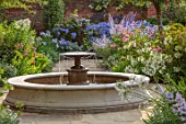 MORTON HALL GARDENS, WORCESTERSHIRE: SOUTH GARDEN, FOUNTAIN, BORDERS, AGAPANTHUS POLAR STAR, PEROVSKIA BLUE SPIRE, ROSES, ROSA OLD BLUSH CHINA, AGAPANTHUS NORTHERN STAR