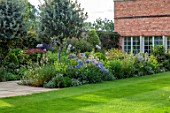 MORTON HALL GARDENS, WORCESTERSHIRE: SOUTH GARDEN, LAWN, BORDERS, NICOTIANA ALATA LIME GREEN, AGAPNTHUS BLUE TRIUMPHATOR, SIDALCEA ELSIE HEUGH,