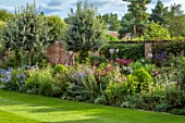 MORTON HALL GARDENS, WORCESTERSHIRE: SOUTH GARDEN, BORDERS, NICOTIANA LIME GREEN, PEROVSKIA BLUE SPIRE, CLEMATIS KERMESINA, SIDALCEA ELSIE HEUGH, AGAPANTHUS BLUE TRIUMPHATOR