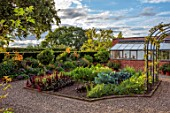 MORTON HALL GARDENS, WORCESTERSHIRE: WEST GARDEN, HOT BORDERS, ORANGE FLOWERS OF LILIUM HENRYI, VEGETABLE GARDEN, POTAGER, SUMMER, GREENHOUSE, ARCHES, ARCHWAY