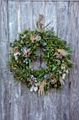 BABYLON FLOWERS, OXFORDSHIRE - NATURAL WREATH ON GREY DOOR, WINTER, CHRISTMAS DECORATIONS, FRESH FIR, IVY, PINE CONE, NIGELLA SEED HEADS, HONESTY, HYDRANGEA HEADS